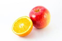 Apple with half orange. Apple with half orange on white background Stock Photo