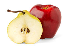 Apple and half of pear. Red apple and half of yellow pear over white background royalty free stock photo