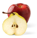 Apple and half of pear. Hald of yellow pear and red apple with waterdrops stock photos