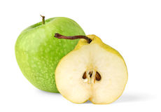 Apple and half of pear. Isolated fruits. Green apple and half of yellow pear isolated on white background royalty free stock images