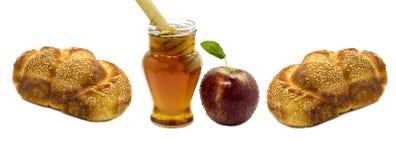Apple, halllah y miel aislados en blanco Foto de archivo