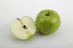 Apple. Halved apple on white background Royalty Free Stock Photography