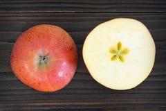 Apple halves on wooden background. Apple halves on dark wooden background royalty free stock image