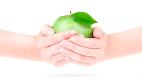 Apple in the hand Royalty Free Stock Images