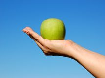 Apple In Hand Royalty Free Stock Photos