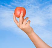 Apple in hand. Close up of apple in hand Stock Photos