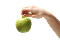 Apple in hand. Tasty sweet apple in graceful woman's hand stock photos