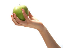 Apple in hand. Tasty sweet apple in graceful woman's hand stock photography