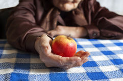 Apple in hand Royalty Free Stock Images