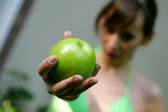 Apple in the hand. Girl plunks a apple off an apple tree Royalty Free Stock Photo
