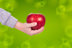 Apple in hand Stock Photos