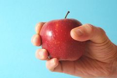 Apple on the Hand Royalty Free Stock Photos