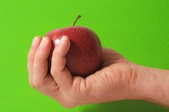 Apple on the Hand Royalty Free Stock Photography