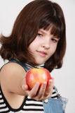 Apple in a hand of the girl Stock Images