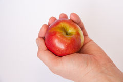 Apple in hand Royalty Free Stock Image