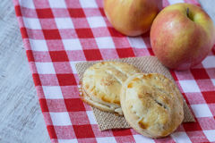 Apple Hand Pies In Autumn. Autumn apple hand pies on red checkered napkin Royalty Free Stock Image