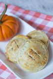 Apple Hand Pies and Pumpkin On Red Checkered Napkin Stock Photo