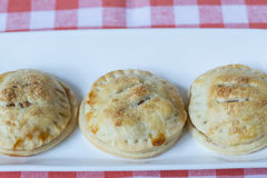 Apple Hand Pies In a Row On Red Napkin Stock Image