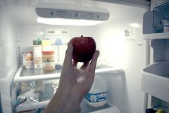 Apple, Hand, Refrigerator Royalty Free Stock Image