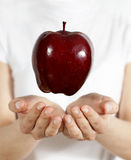 Apple in a hand Royalty Free Stock Photos