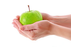 Apple in hands Stock Image