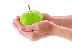 Apple in hands Stock Image