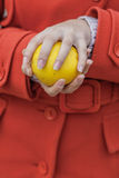 Apple in hands of woman Stock Images