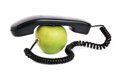 Apple with handset and wire Stock Image