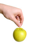 Apple hanging from hand Royalty Free Stock Photos