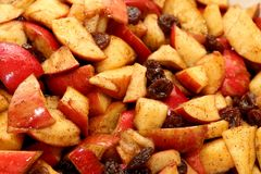 Apple Haroset for Passover. Sliced apples with cinnamon, brown sugar and raisins for Passover Royalty Free Stock Images