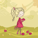 Apple harvest. Girl picking up apples on a windy autumn day Stock Image