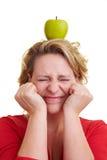 Apple on the head royalty free stock photos