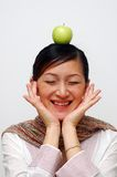Apple On Head. Apple on a Chinese young lady head. Funny Royalty Free Stock Image