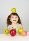 Apple on head of a cheerful girl Stock Photo