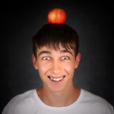 Apple on the Head. Cheerful Teenager with an Apple on the Head Royalty Free Stock Photography