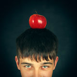 Apple on the Head. Part of Face of Teenager with an Apple on the Head Royalty Free Stock Photo