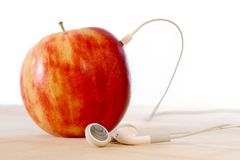 Apple and headphone Royalty Free Stock Images