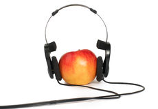 Apple and headphone Royalty Free Stock Photography