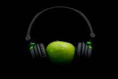Apple with headphone Stock Image