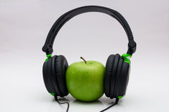 Apple with headphone Royalty Free Stock Photography