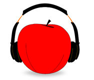 Apple with headphones Royalty Free Stock Photos