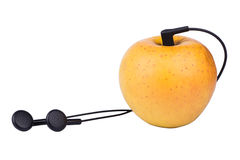 Apple and headphones Royalty Free Stock Photography