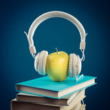Apple with headphones Royalty Free Stock Images