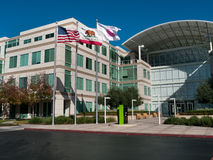 Apple headquarters in Cupertino California. At Infinite Loop 1. US, California and Apple's flag blow in the wind Royalty Free Stock Photo