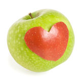 Apple with heart. Green apple with heart silhouette Royalty Free Stock Photos