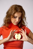 Apple on heart Royalty Free Stock Images