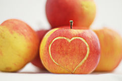 Apple with heart Stock Photography