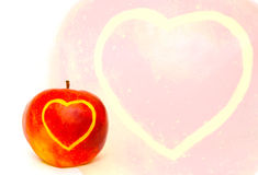 Apple with heart card. The image of the apple on which heart is cut out Royalty Free Stock Photography
