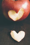 Apple with a heart cut into it Stock Image