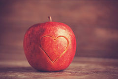 Apple with a heart cut into it Stock Photos